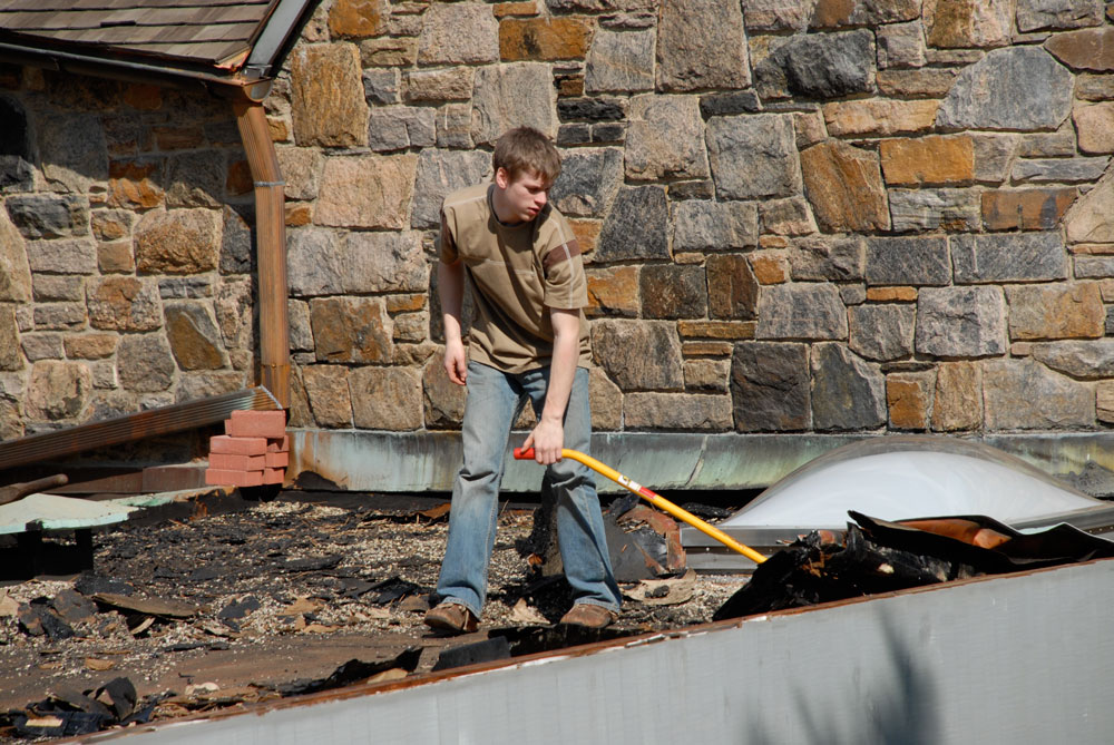 Andre stripping a roof when he was 16 years old