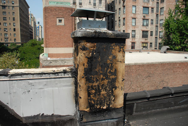 Above is a chimney in manhattan ny the tar that covered cracks in