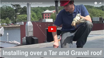 Installing a flat roof over Tar and Gravel roof. This is a two ply roofing system that is the best in the industry -Watch the video
