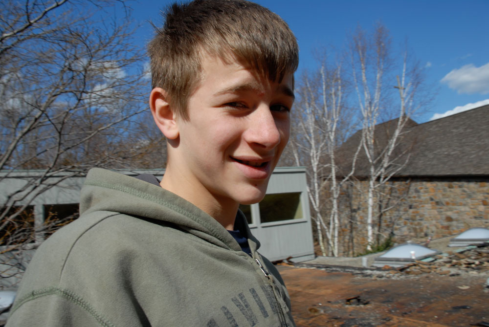 Sven, at the age of 14 taking pictures and videos on roofs we worked on.