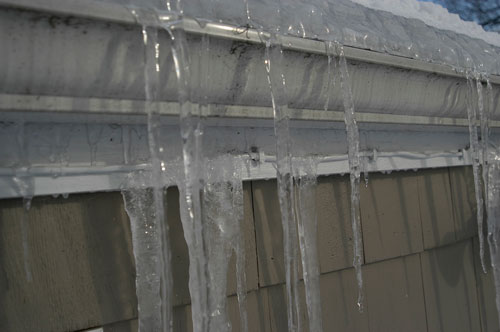 Gutter frozen and can not drain