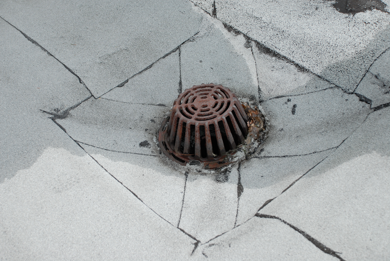 A recessed area around a drain to collect debris