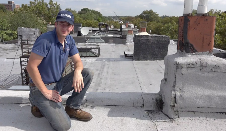 A Brownstone chimney is wrapped with rubber roof membrane.