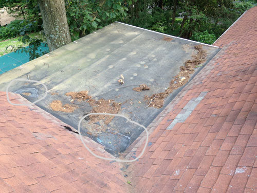 This small EPDM roof already had several patches.