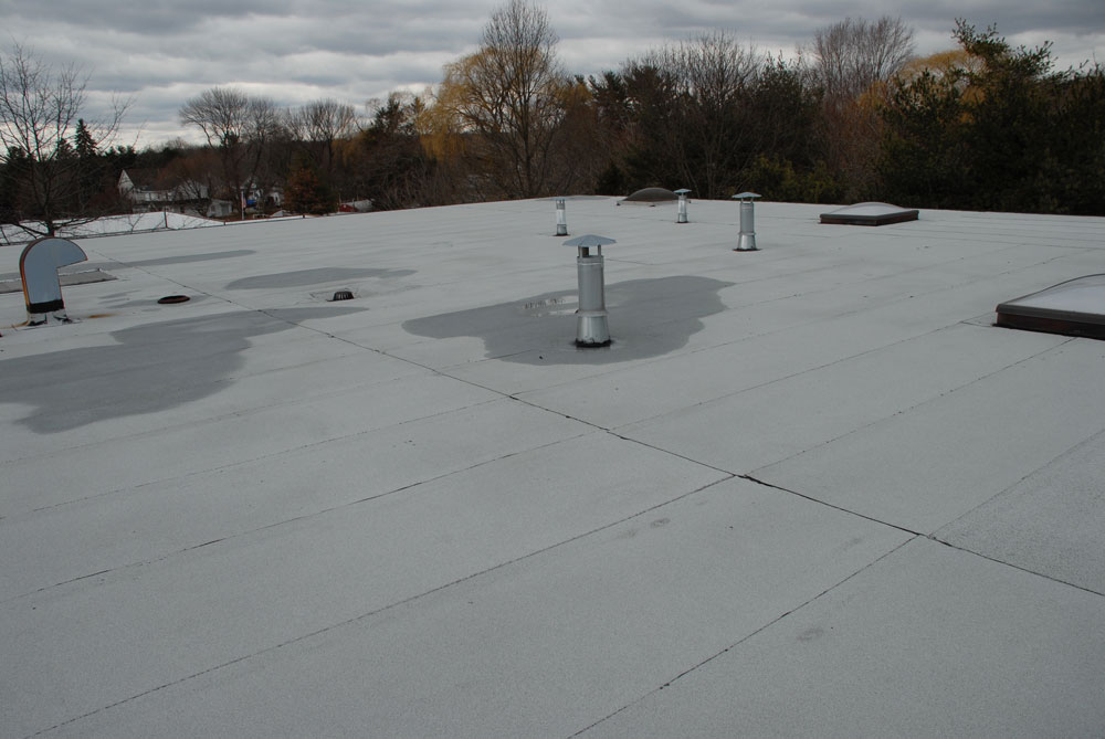 Modified Bitumen Membrane roof Westport CT. This 2 ply rubber roof is 20 years old and there are no patches.