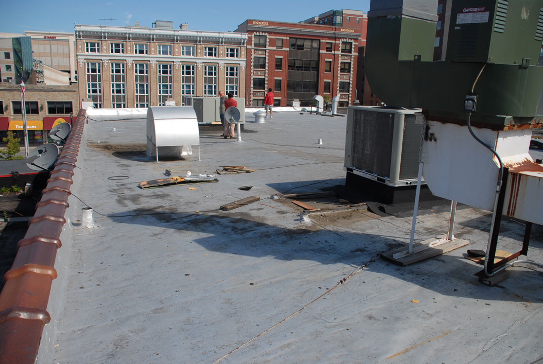 Debris on a commercial roof Stamford. this flat roof shows how much abuse it can take. All the debris and work that was done on top of it.