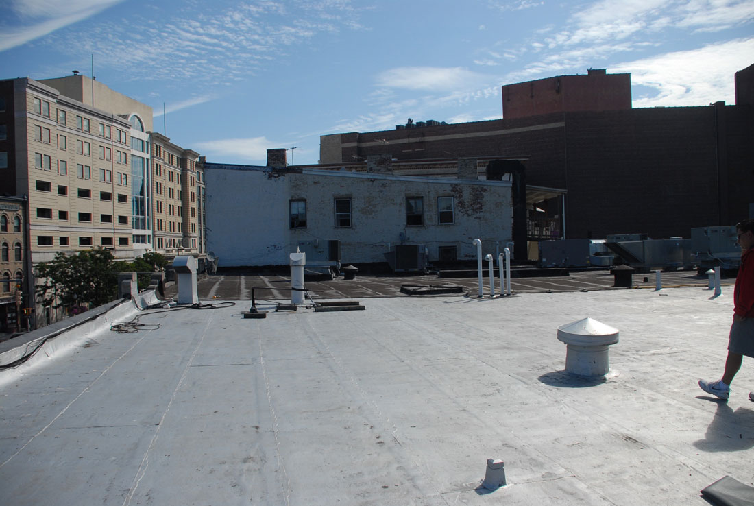 Commercial roofs in Stamford, Connecticut. This Torch Down roof was installed over 20 years ago and with all the traffic and abuse held up very well.