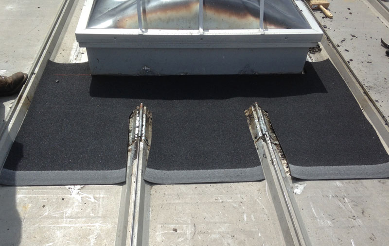Installing a rubber membrane around a skylight on a metal roof