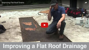 Improving-drainage-for-a-flat-roof by lowering the drain Watch video