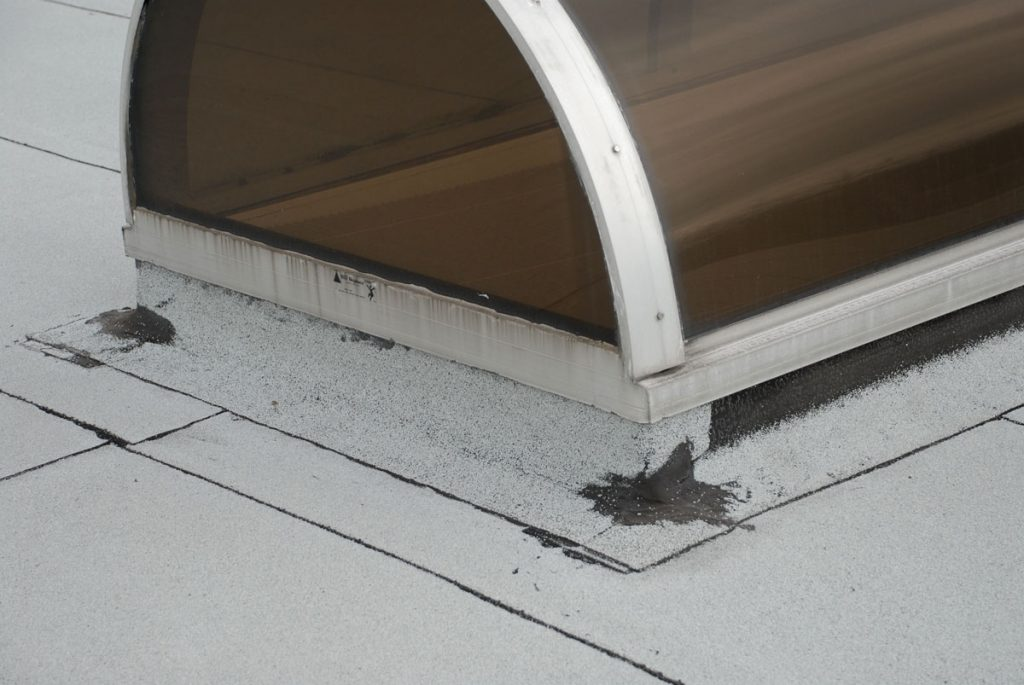 After installing the final layer, details like corners of skylights and a/c units must be sealed