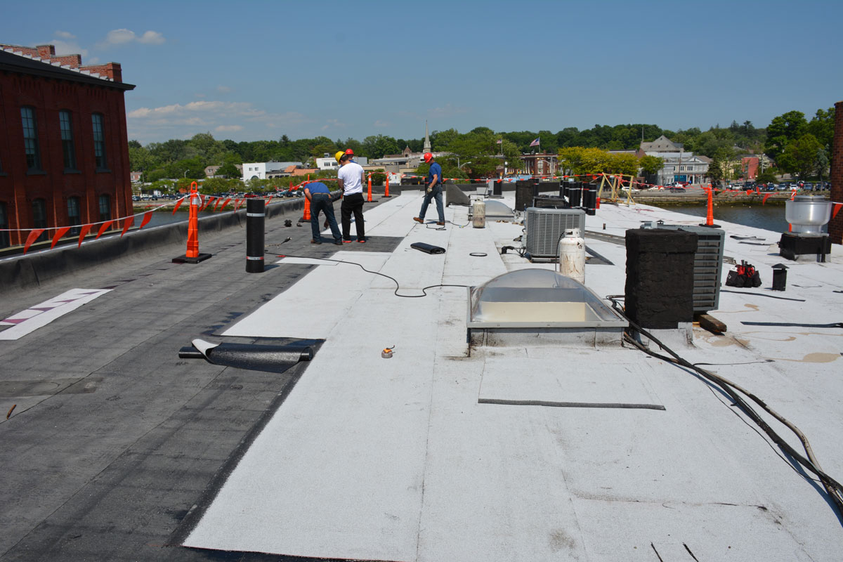 In the process of Installing a Two Ply Rubber Roof over a gravel Rock roof