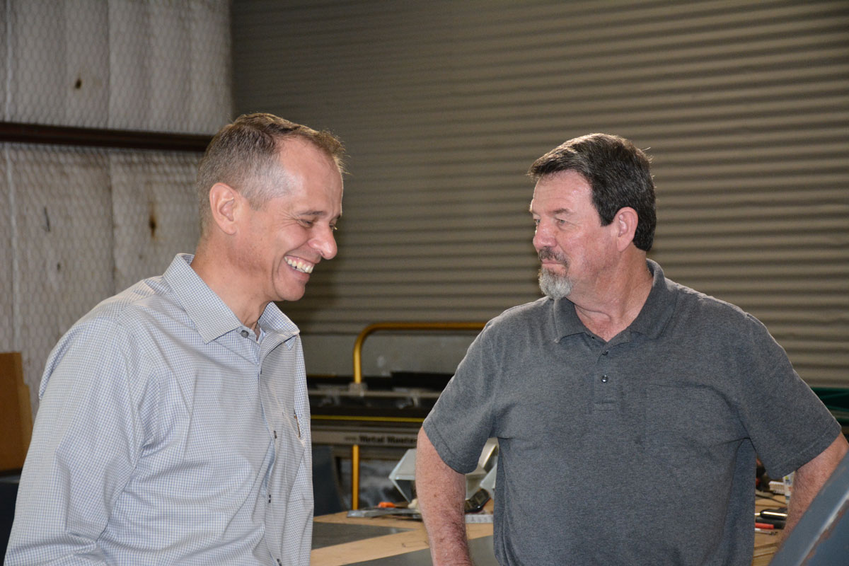 Dos discussing with Terry at Clean Cut roofing Metal Shop