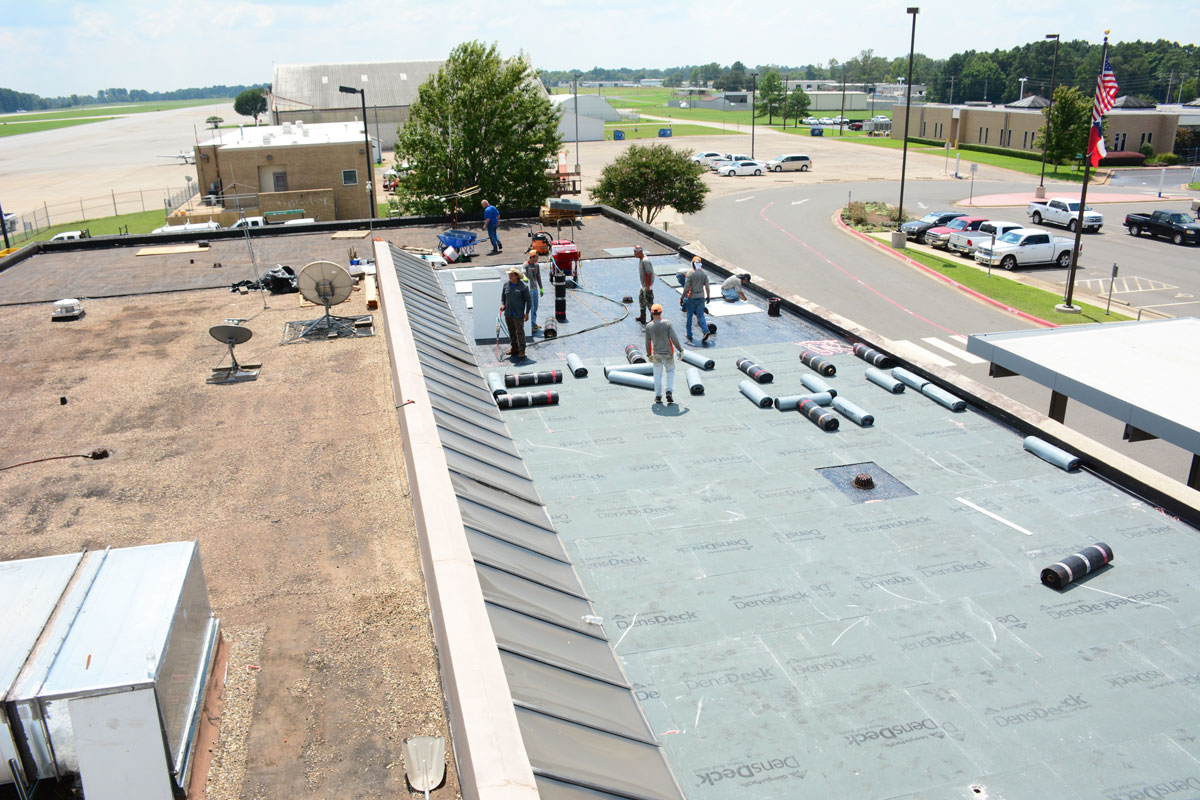 Working on a commercial flat roof in East Texas Regional Airport.