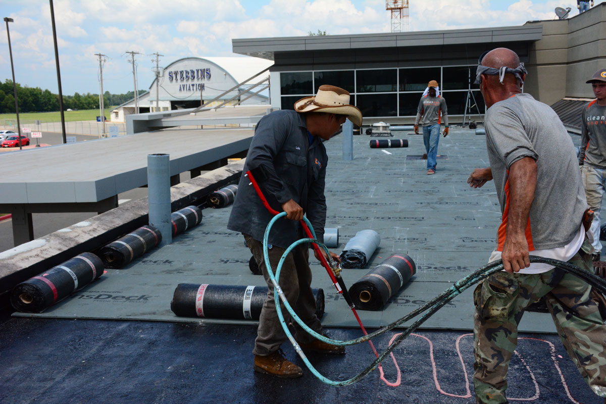Installing Commercial roof at East Texas Regional Airport by Clean Cut Roofing
