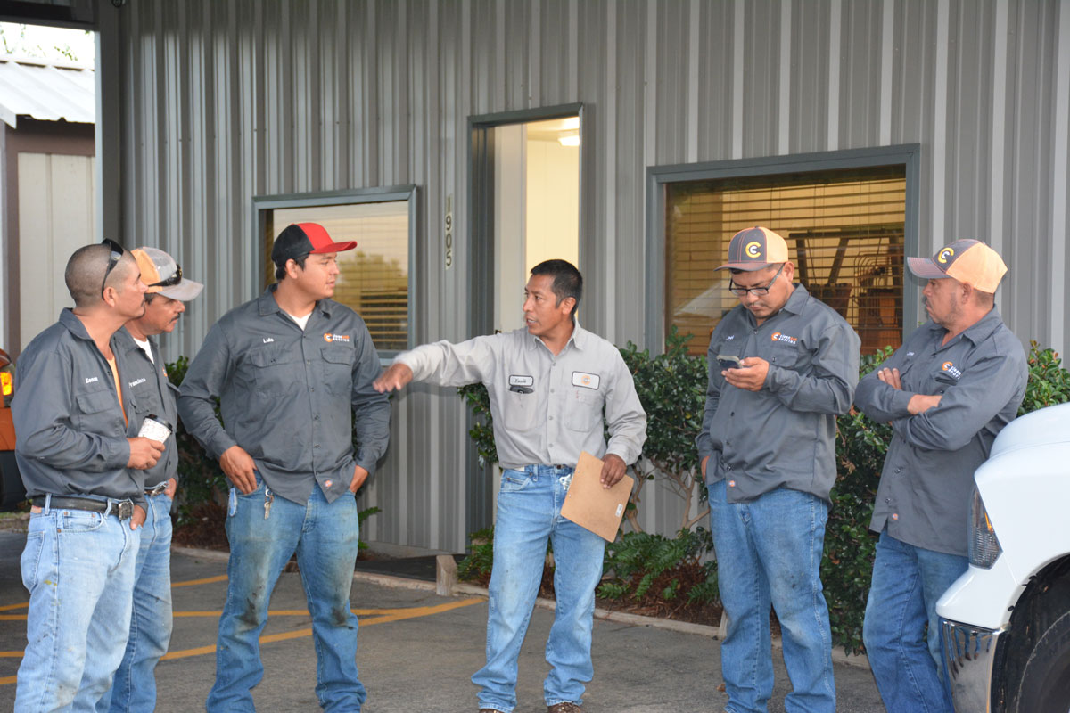 Yauli instructing work crews Clean Cut Roofing Longview Texas