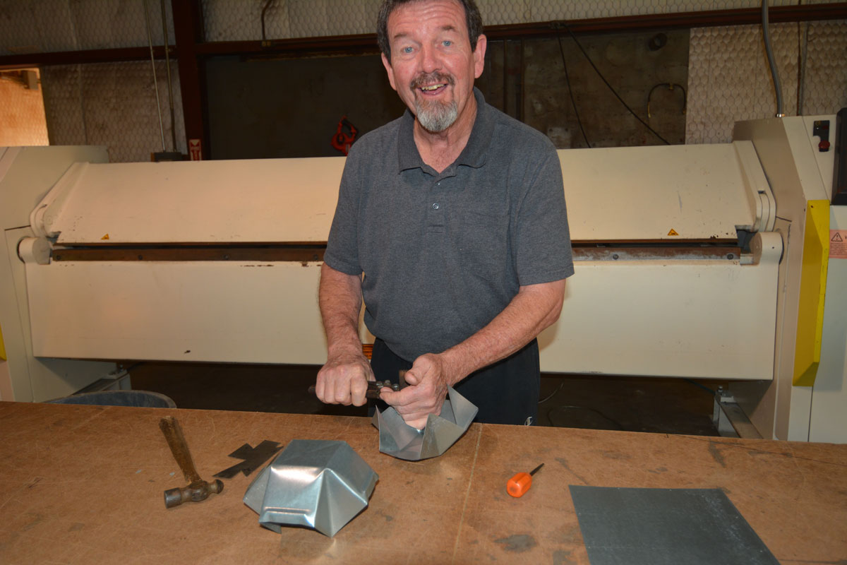 Terry making metal vents at Clean Cut roofing Metal Shop