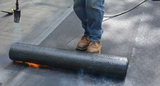Torching down or heat fusing a Modified Bitumen Rubber Membrane